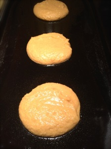 Pumpkin Spice Pancakes cooking on the griddle.