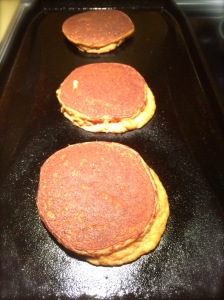 Pumpkin Spice Pancakes flipped on the griddle and ready for a hungry plate!