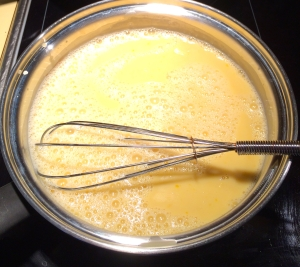 Whisking the creamy ice cream base.